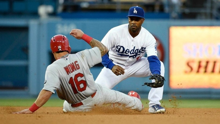 Jun 5, 2015; Los Angeles, CA, USA; St. Louis Cardinals second baseman Kolten Wong (16) is tagged out by Los Angeles Dodgers shortstop Jimmy Rollins (11) in the third inning during the game at Dodger Stadium. Mandatory Credit: Richard Mackson-USA TODAY Sports