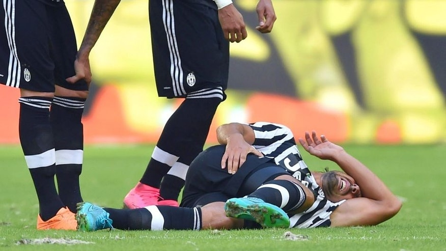MARSEILLE, FRANCE - AUGUST 01: Sami Khedira (C) of Juventus FC lies injured during the preseason friendly match between Olympique de Marseille and Juventus FC at Stade Velodrome on August 1, 2015 in Marseille, France. (Photo by Valerio Pennicino/Getty Images)