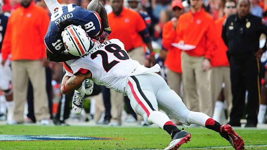AUBURN, AL - NOVEMBER 16: Sammie Coates #18 of the Auburn Tigers is tackled by Tray Matthews #28 of the Georgia Bulldogs at Jordan-Hare Stadium on November 16, 2013 in Auburn Alabama. (Photo by Scott Cunningham/Getty Images)