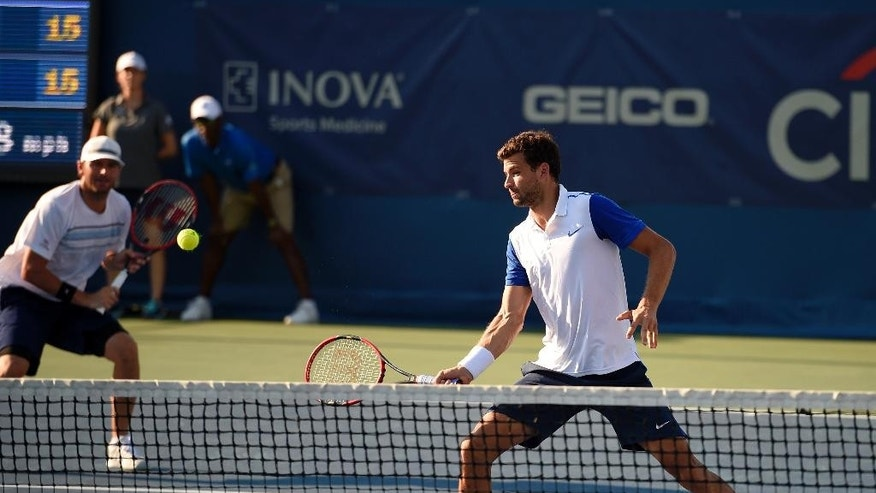 Grigor Dimitrov, of Bulgaria, right, and Mardy Fish, back left, during a doubles match against Jack Sock and Vasek Pospisil, of Canada, at the Citi Open tennis tournament, Monday, Aug. 3, 2015, in Washington. (AP Photo/Nick Wass)