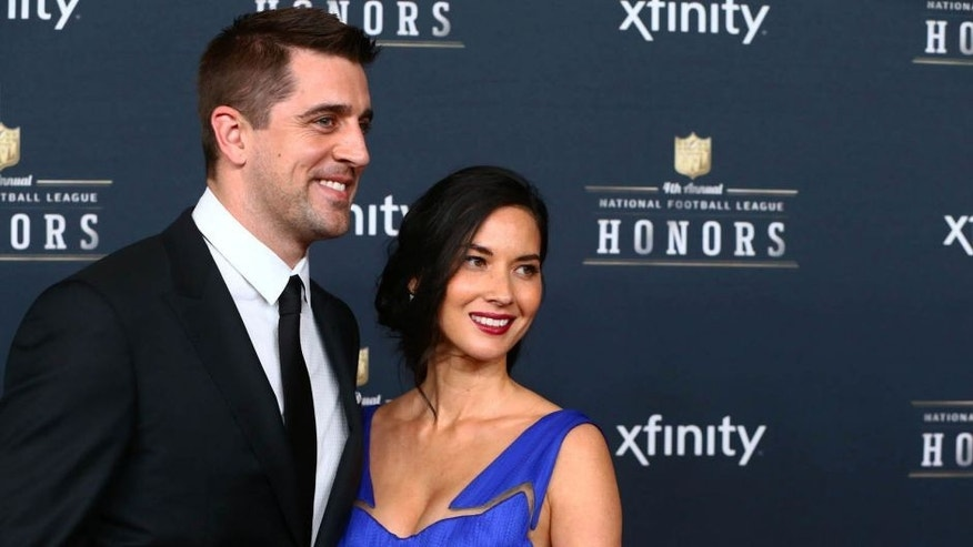 Saturday, January 31: Green Bay Packers quarterback Aaron Rodgers and girlfriend actress Olivia Munn pose on the red carpet prior to the NFL Honors award ceremony at Symphony Hall in Phoenix, where Rodgers was selected the AP Most Valuable Player.