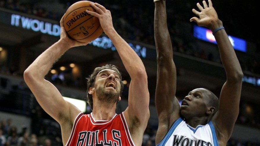 <p>Nov 1, 2014; Minneapolis, MN, USA; Chicago Bulls forward Pau Gasol (16) shoots over Minnesota Timberwolves center Gorgui Dieng (5) during the first quarter at Target Center. Mandatory Credit: Brace Hemmelgarn-USA TODAY Sports</p>