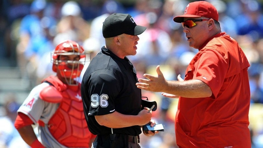 <p>August 1, 2015; Los Angeles, CA, USA; Los Angeles Angels manager Mike Scioscia (14) argues his ejection call with umpire Chris Segal during the second inning at Dodger Stadium. Mandatory Credit: Gary A. Vasquez-USA TODAY Sports ,August 1, 2015; Los Angeles, CA, USA; Los Angeles Angels manager Mike Scioscia (14) argues his ejection call with umpire Chris Segal during the second inning at Dodger Stadium. Mandatory Credit: Gary A. Vasquez-USA TODAY Sports</p>