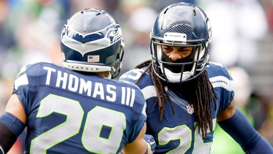 Dec 28, 2014; Seattle, WA, USA; Seattle Seahawks cornerback Richard Sherman (25) shakes hands with Seattle Seahawks free safety Earl Thomas (29) during pre game warmups against the St. Louis Rams at CenturyLink Field. Mandatory Credit: Joe Nicholson-USA TODAY Sports