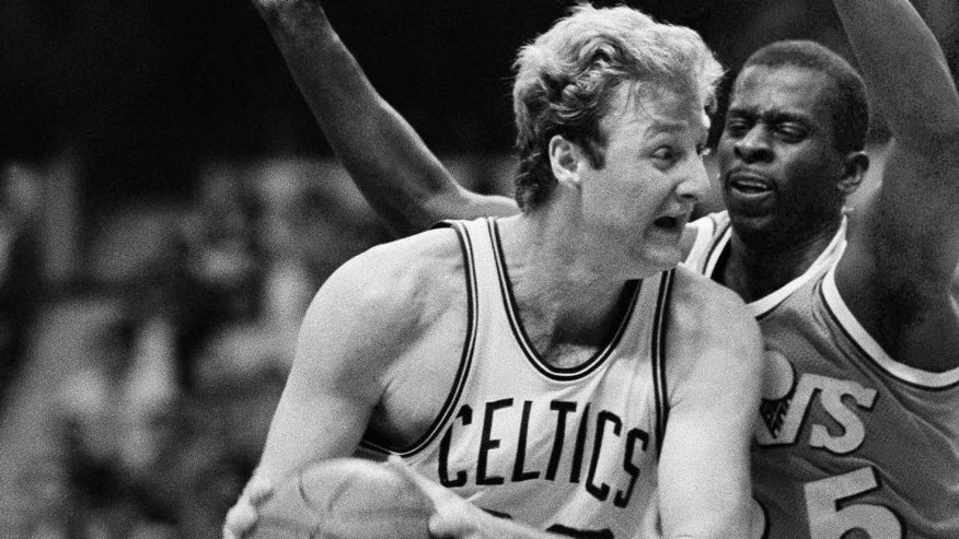 Boston Celtics forward Larry Bird, left, drives past Cleveland Cavaliers forward Phil Hubbard, right, on his way to the basket late in the fourth period of the NBA playoff game at Boston Garden, Thursday, April 19, 1985, Boston, Mass. Bird scored 40 points to lead the Celtics to a 126-123 win, and a 1-0 edge in the best-of-five series. (AP Photo/Peter Southwick)