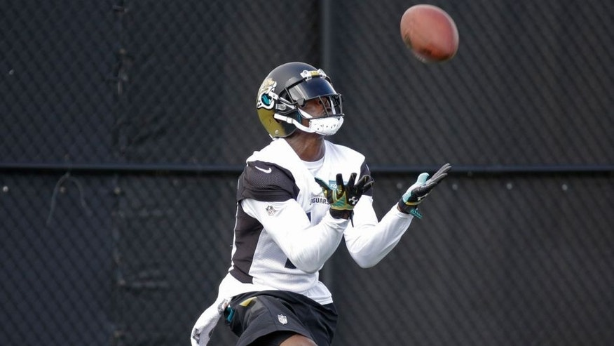 Jacksonville Jaguars' Marqise Lee catches a punt for a return during practice at NFL football training camp, Saturday, Aug. 1, 2015, in Jacksonville, Fla. (AP Photo/John Raoux)