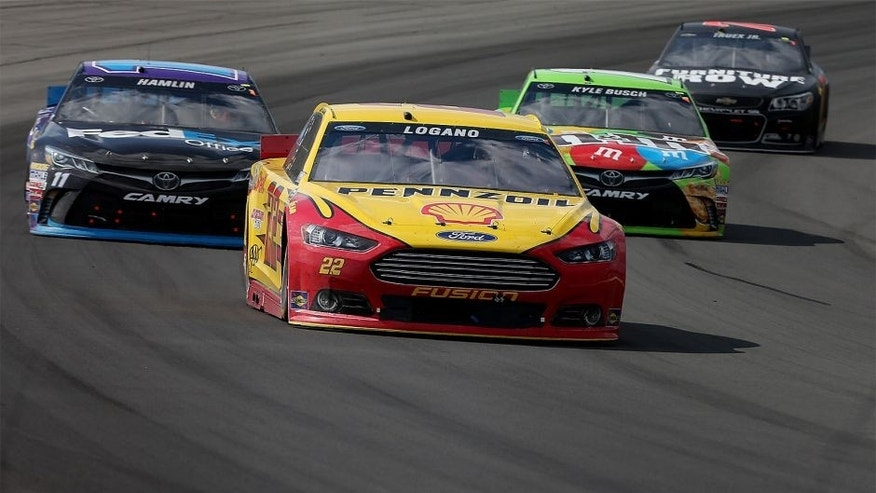 LONG POND, PA - AUGUST 02: Joey Logano, driver of the #22 Shell Pennzoil Ford, leads a pack of cars during the NASCAR Sprint Cup Series Windows 10 400 at Pocono Raceway on August 2, 2015 in Long Pond, Pennsylvania. (Photo by Nick Laham/Getty Images)