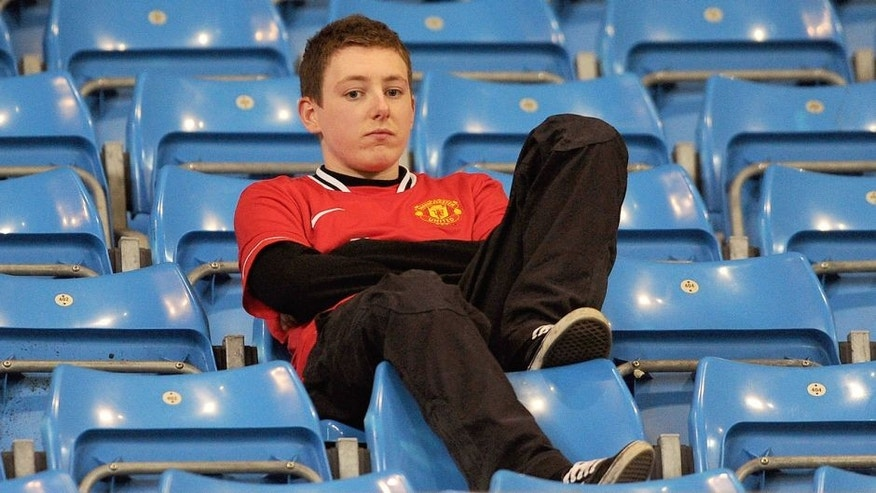 MANCHESTER, ENGLAND - APRIL 30: A Manchester United fan looks dejected at the end of the Barclays Premier League match between Manchester City and Manchester United at the Etihad Stadium on April 30, 2012 in Manchester, England. (Photo by Michael Regan/Getty Images)