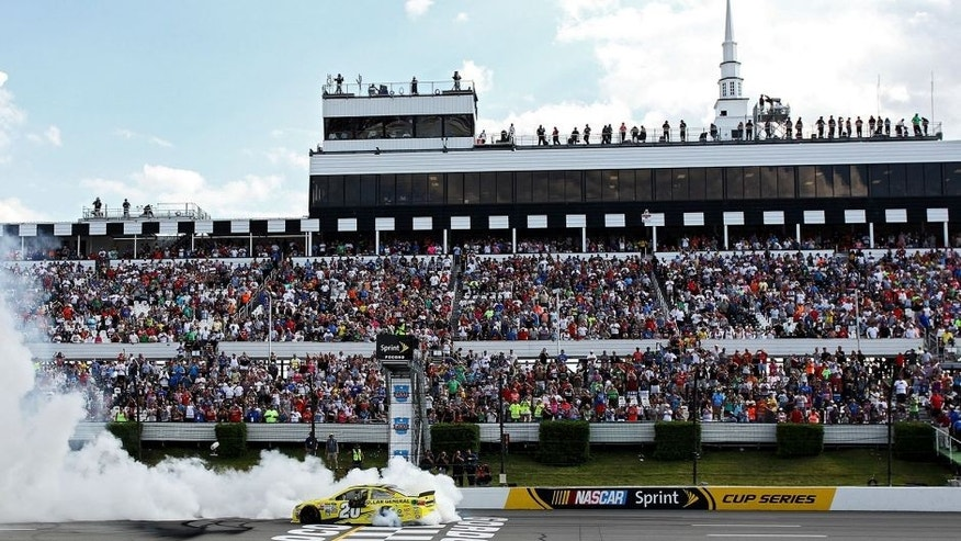LONG POND, PA - AUGUST 02: Matt Kenseth, driver of the #20 Dollar General Toyota, celebrates with a burnout after winning the NASCAR Sprint Cup Series Windows 10 400 at Pocono Raceway on August 2, 2015 in Long Pond, Pennsylvania. (Photo by Tim Bradbury/Getty Images)