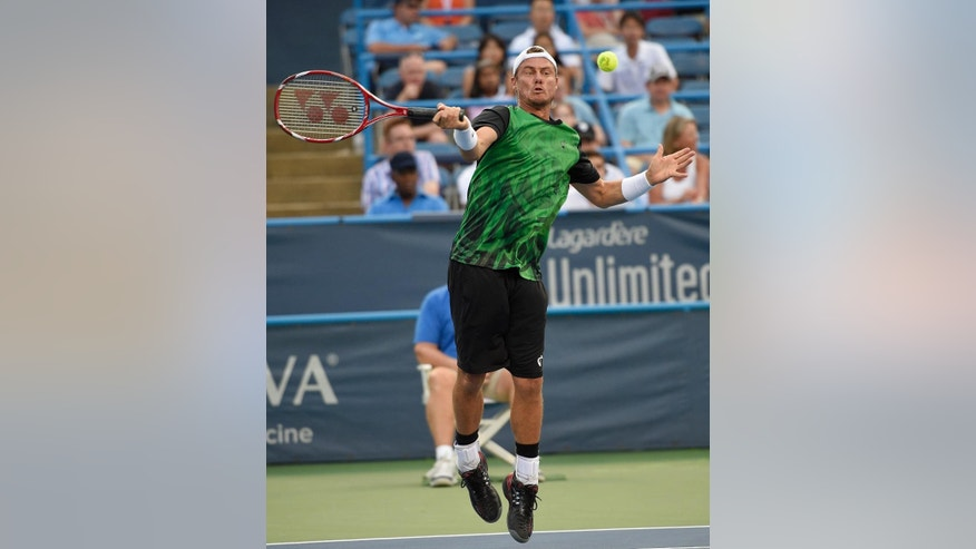 Lleyton Hewitt, of Australia, jumps up for the ball during a match against John-Patrick Smith, of Australia, at the Citi Open tennis tournament, Tuesday, Aug. 4, 2015, in Washington. (AP Photo/Nick Wass)