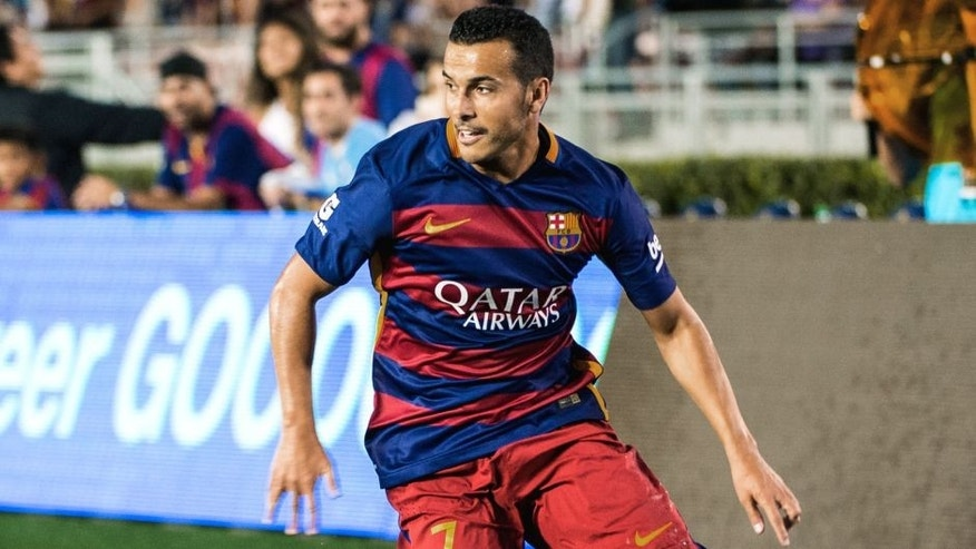 PASADENA, CA - JULY 21: Pedro #7 of Barcelona brings the ball down the wing during the International Champions Cup 2015 match between FC Barcelona and Los Angeles Galaxy at the Rose Bowl on July 21, 2015 in Pasadena, California. Barcelona won the match 2-1 (Photo by Shaun Clark/Getty Images)