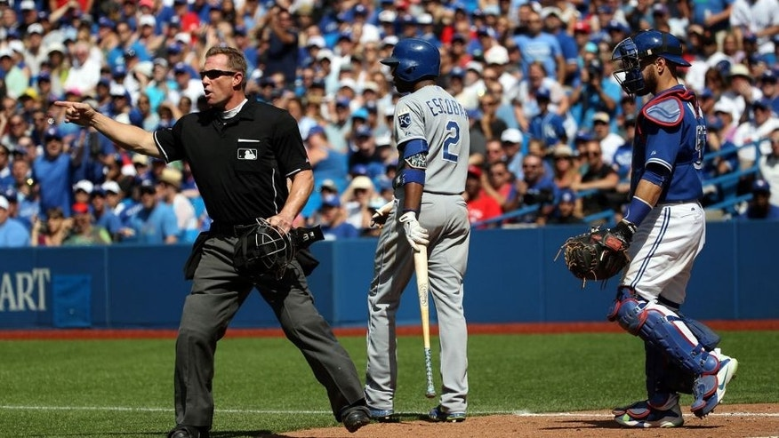 Toronto, Canada - August 2 - Umpire Jim Wolf (28) calls out Toronto Blue Jays starting pitcher Aaron Sanchez (41) for hitting Kansas City Royals shortstop Alcides Escobar (2) with a pitch during MLB action at the Rogers Centre in Toronto on August 2, 2015. (Cole Burston/Toronto Star via Getty Images)