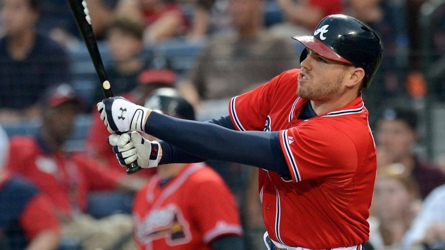 Aug 30, 2013; Atlanta, GA, USA; Atlanta Braves first baseman Freddie Freeman (5) watches his two run home run against the Miami Marlins during the first inning at Turner Field. The Braves defeated the Marlins 2-1. Mandatory Credit: Dale Zanine-USA TODAY Sports