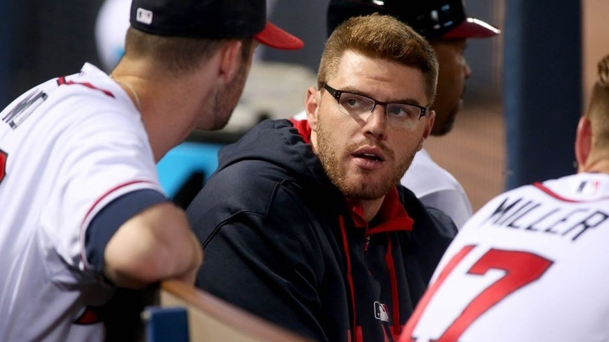 Jul 17, 2015; Atlanta, GA, USA; Atlanta Braves first baseman Freddie Freeman (C) talks with starting pitcher Alex Wood (40) in the dugout in the fourth inning of their game against the Chicago Cubs at Turner Field. Mandatory Credit: Jason Getz-USA TODAY Sports