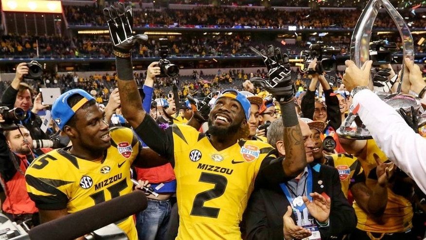 Jan 3, 2014; Arlington, TX, USA; Missouri Tigers wide receiver Dorial Green-Beckham (left) and wide receiver L'Damian Washington (2) celebrate the victory against the Oklahoma State Cowboys in the 2014 Cotton Bowl at AT&T Stadium. Missouri won 41-31. Mandatory Credit: Kevin Jairaj-USA TODAY Sports