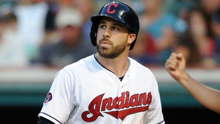 Jul 24, 2015; Cleveland, OH, USA; Cleveland Indians second baseman Jason Kipnis (22) walks off the field after striking out during the fifth inning against the Chicago White Sox at Progressive Field. Mandatory Credit: Ken Blaze-USA TODAY Sports