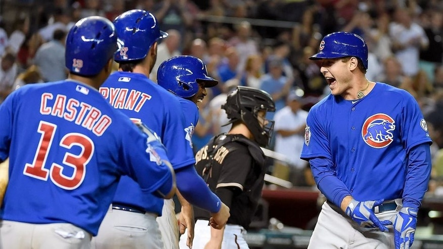 PHOENIX, AZ - MAY 23: Anthony Rizzo #44, Starlin Castro #13, Kris Bryant #17 and Dexter Fowler #24 of the Chicago Cubs celebrate a three run home run during the ninth inning against the Arizona Diamondbacks at Chase Field on May 23, 2015 in Phoenix, Arizona. Cubs won 9-6. (Photo by Norm Hall/Getty Images)