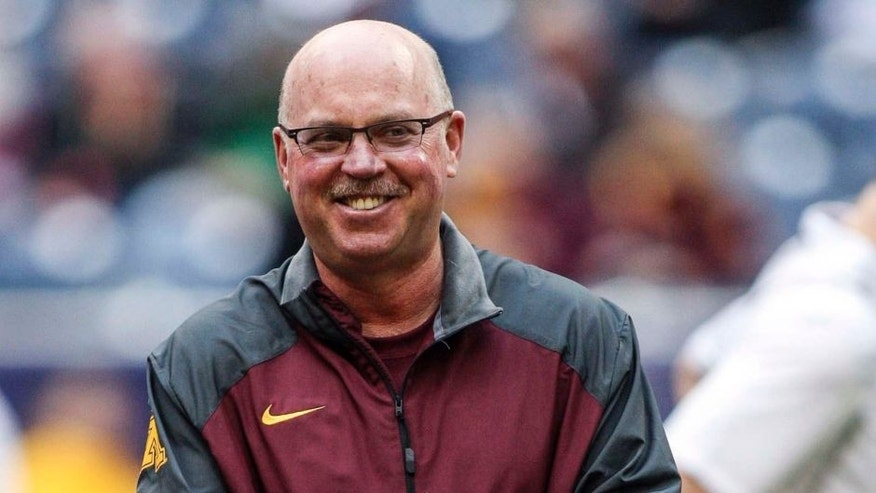 Dec 27, 2013; Houston, TX, USA; Minnesota Golden Gophers head coach Jerry Kill walks on the field before the Texas Bowl against the Syracuse Orange at Reliant Stadium.