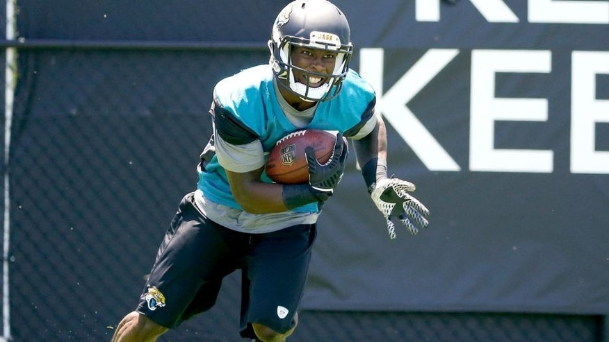 JACKSONVILLE, FL - MAY 16: Marqise Lee #11 of the Jacksonville Jaguars works out during rookie minicamp at Everbank Field on May 16, 2014 in Jacksonville, Florida. (Photo by Rob Foldy/Getty Images)