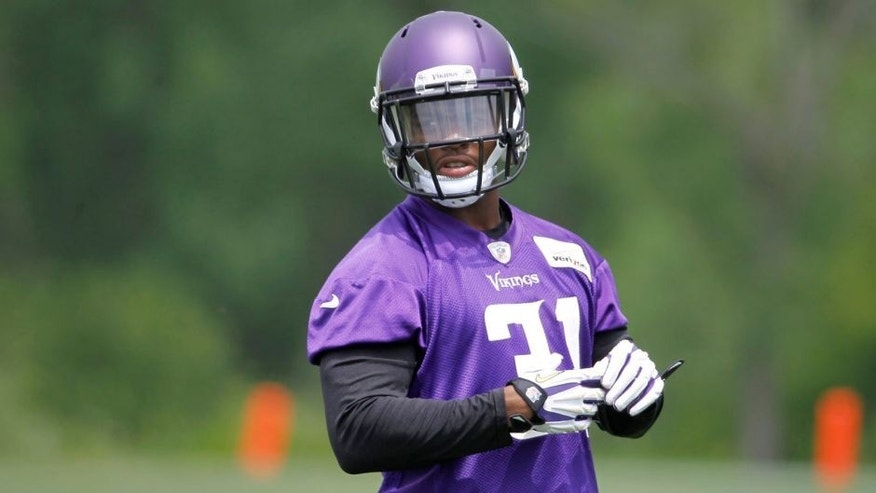 <p>Minnesota Vikings running back Jerick McKinnon listens to instructions during an NFL mini camp in Eden Prairie, Minn., Tuesday, June 17, 2014. The Vikings are hoping McKinnon's versatility and speed can provide a productive complement to Adrian Peterson in the backfield this season. (AP Photo/Ann Heisenfelt)</p>