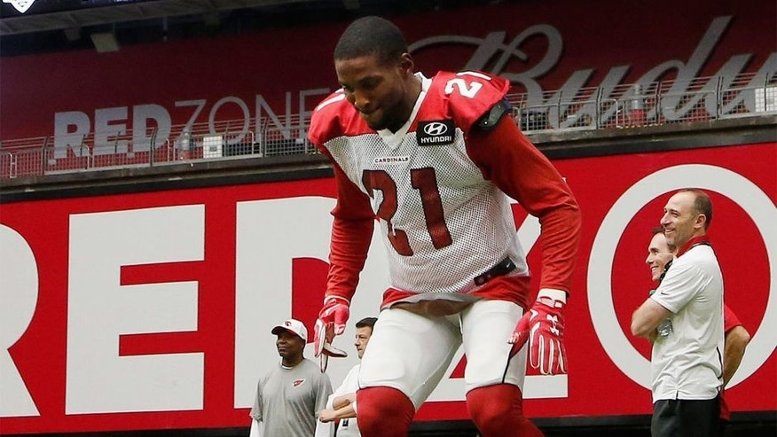 Arizona Cardinals' Patrick Peterson warms up during an NFL football training camp practice, Monday, Aug. 3, 2015, in Glendale, Ariz. (AP Photo/Ross D. Franklin)