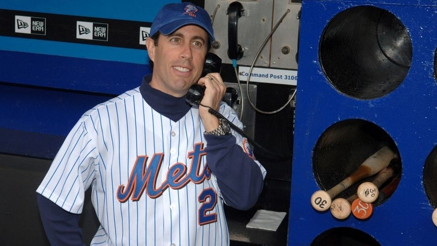 "Jerry Seinfeld during Jerry Seinfeld Throws The First Pitch at The Mets/Yankees Subway Series Game to Promote The Release of the ""Seinfeld"" Season 4 DVD at Shea Stadium in New York City, New York, United States. (Photo by Stephen Lovekin/WireImage)"