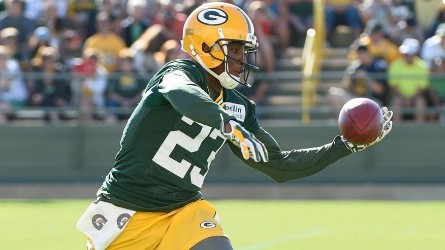 <p>Jul 30, 2015; Green Bay, WI, USA; Green Bay Packers cornerback Damarious Randall tries to catch a pass during training camp at Ray Nitschke Field. Mandatory Credit: Benny Sieu-USA TODAY Sports</p>