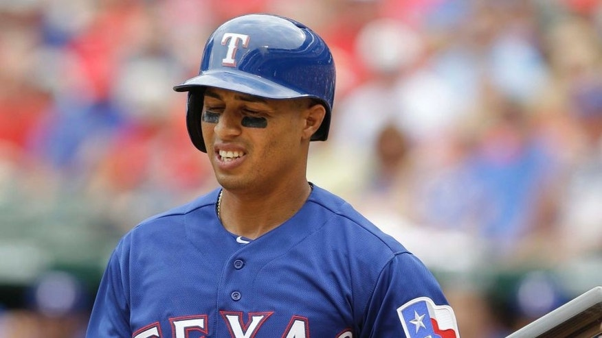Texas Rangers' Leonys Martin reacts to a third strike ending the third inning of a baseball game against the Houston Astros in Arlington, Texas, Sunday, April 12, 2015. (AP Photo/LM Otero)