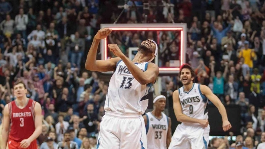 Friday, April 11: Minnesota Timberwolves forward Corey Brewer (center) celebrates scoring 51 points at the end of the game against Houston Rockets at Target Center. The Minnesota Timberwolves won 112-110.