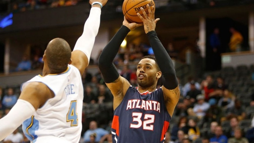 Mar 11, 2015; Denver, CO, USA; Atlanta Hawks forward Mike Scott (32) shoots the ball over Denver Nuggets guard Randy Foye (4) during the first half at Pepsi Center. Mandatory Credit: Chris Humphreys-USA TODAY Sports