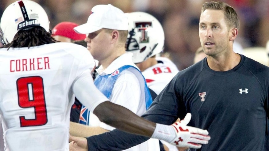 DALLAS, TX - AUGUST 30: Head coach Kliff Kingsbury of the Texas Tech Red Raiders celebrates with his team after a touchdown against the SMU Mustangs on August 30, 2013 at Gerald J. Ford Stadium in Dallas, Texas. (Photo by Cooper Neill/Getty Images)