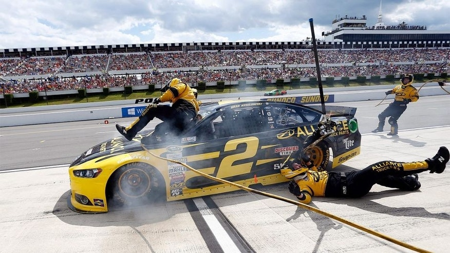 LONG POND, PA - AUGUST 02: Brad Keselowski, driver of the #2 Alliance Truck Parts Ford, crashes into his crew on pit road during the NASCAR Sprint Cup Series Windows 10 400 at Pocono Raceway on August 2, 2015 in Long Pond, Pennsylvania. (Photo by Jeff Zelevansky/NASCAR via Getty Images)