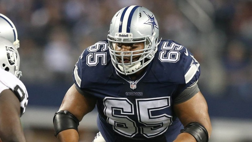 Nov 28, 2013; Arlington, TX, USA; Dallas Cowboys guard Ronald Leary (65) in action against the Oakland Raiders during a NFL football game on Thanksgiving at AT&T Stadium. Mandatory Credit: Matthew Emmons-USA TODAY Sports
