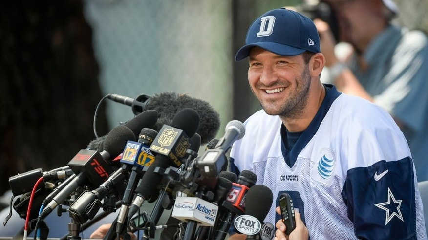 Dallas Cowboys quarterback Tony Romo takes questions from the media after morning practice during Dallas Cowboys NFL football training camp, Thursday, July 30, 2015, in Oxnard, Calif. (AP Photo/Gus Ruelas)