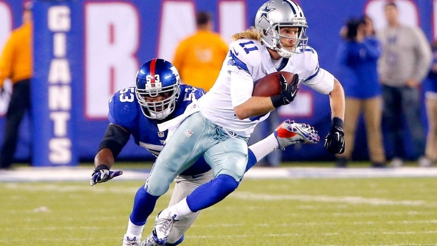 Nov 23, 2014; East Rutherford, NJ, USA; Dallas Cowboys wide receiver Cole Beasley (11) escapes the tackle of New York Giants middle linebacker Jameel McClain (53) during the fourth quarter at MetLife Stadium. Dallas Cowboys defeat the New York Giants 31-28. Mandatory Credit: Jim O'Connor-USA TODAY Sports