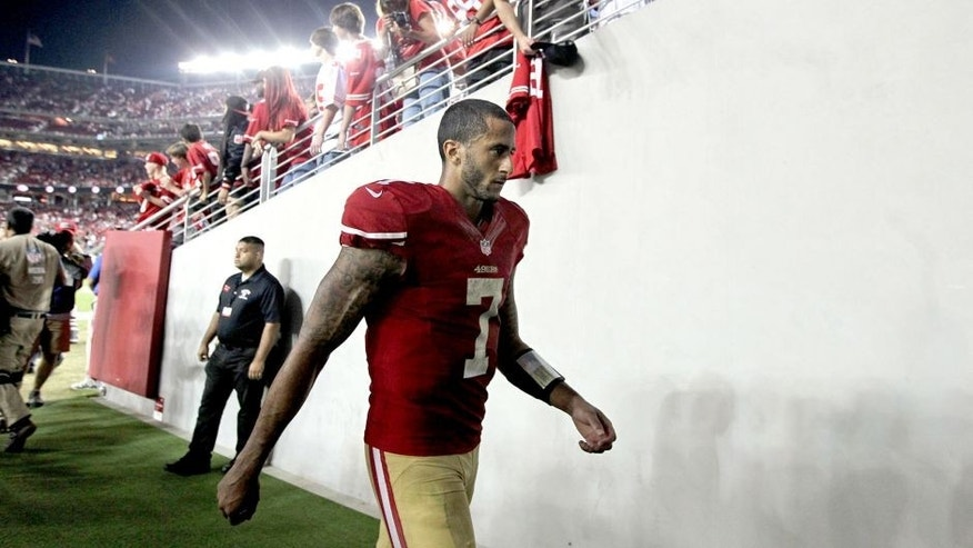 Sep 14, 2014; Santa Clara, CA, USA; San Francisco 49ers quarterback Colin Kaepernick (7) walks off the field after loosing to the Chicago Bears 28-20 at Levis Stadium. Mandatory Credit: Lance Iversen-USA TODAY Sports