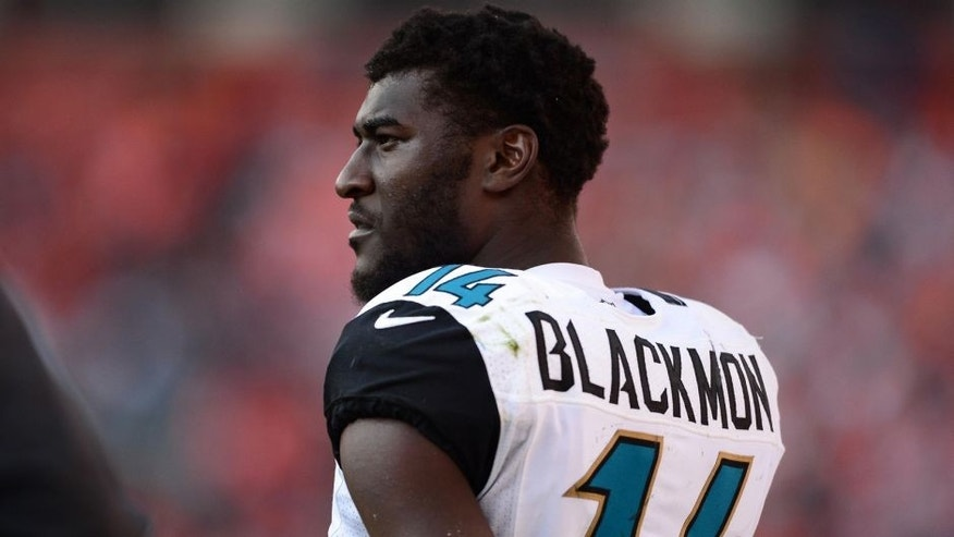Oct 13, 2013; Denver, CO, USA; Jacksonville Jaguars wide receiver Justin Blackmon (14) on the sidelines in the fourth quarter against the Denver Broncos at Sports Authority Field at Mile High. The Broncos defeated the Jaguars 35-19. Mandatory Credit: Ron Chenoy-USA TODAY Sports