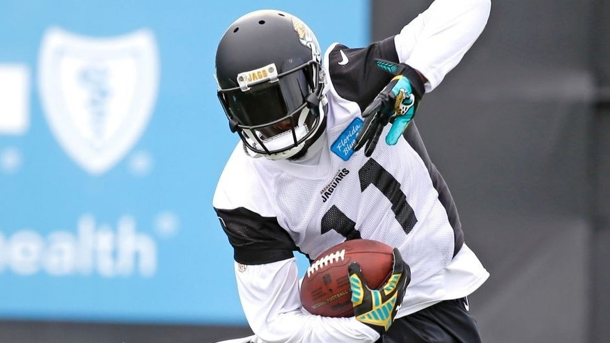 Jacksonville Jaguars wide receiver Marqise Lee makes an effort to stay in bounds after he catches a pass during practice at NFL football training camp, Saturday, Aug. 1, 2015, in Jacksonville, Fla. (AP Photo/John Raoux)