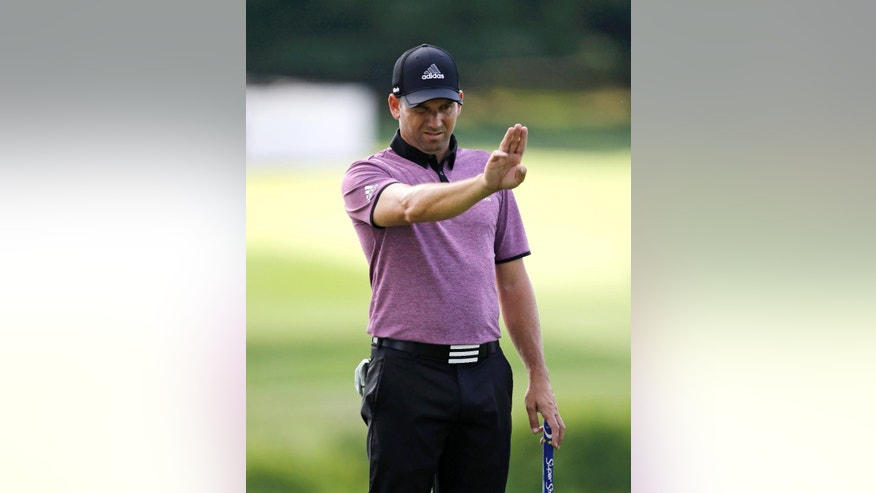Sergio Garcia, from Spain, lines up a putt on the ninth hole during the practice round of the Bridgestone Invitational golf tournament at Firestone Country Club, Wednesday, Aug. 5, 2015, in Akron, Ohio. (AP Photo/Tony Dejak)