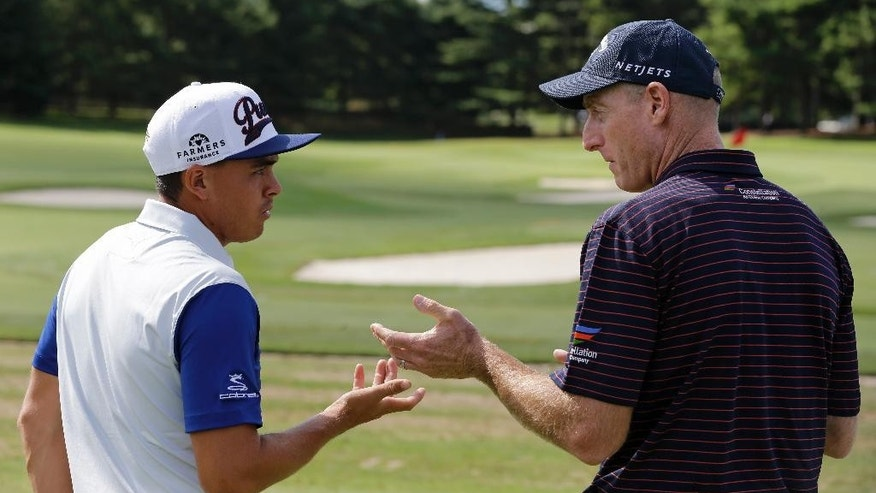 Jim Furyk, right, and Rickie Fowler talk during the practice round of the Bridgestone Invitational golf tournament at Firestone Country Club, Wednesday, Aug. 5, 2015, in Akron, Ohio. (AP Photo/Tony Dejak)