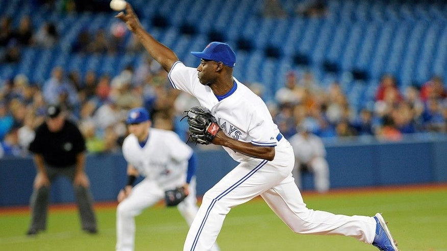 Aug 5, 2015; Toronto, Ontario, CAN; Toronto Blue Jays relief pitcher LaTroy Hawkins (32) pitches against Minnesota Twins in the ninth inning at Rogers Centre. Blue Jays beat Twins 9 - 7. Mandatory Credit: Peter Llewellyn-USA TODAY Sports