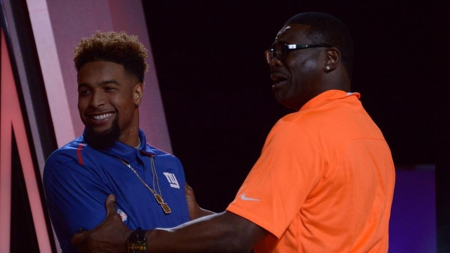 Jan 21, 2015; Phoenix, AZ, USA; New York Giants receiver Odell Beckham (L) shakes hands with Michael Irvin (R) during the 2015 Pro Bowl Draft at The Arizona Biltmore. Mandatory Credit: Kirby Lee-USA TODAY Sports