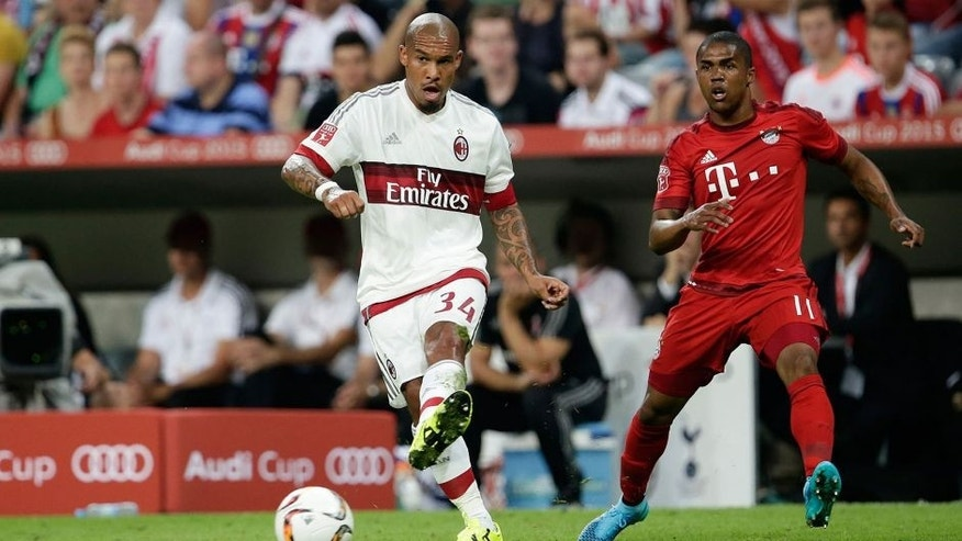 (L-R) Nigel de Jong of AC Milan, Douglas Costa of FC Bayern Munchen during the AUDI Cup match between FC Bayern Munich and AC Milan on August 4, 2015 at the Allianz Arena in Munich, Germany(Photo by VI Images via Getty Images)