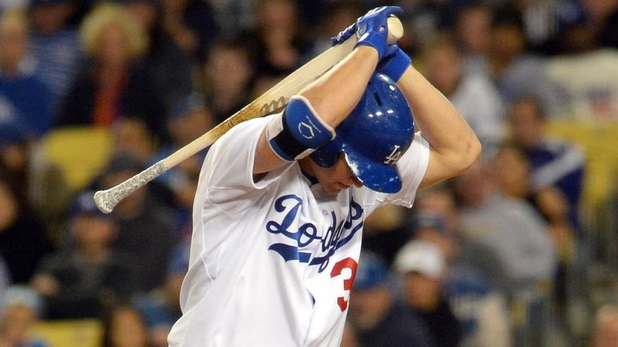 May 23, 2015; Los Angeles, CA, USA; Los Angeles Dodgers center fielder Joc Pederson (31) flips his bat in frustration after striking out in the eighth inning of the game against the San Diego Padres at Dodger Stadium. Dodgers won 2-0. Mandatory Credit: Jayne Kamin-Oncea-USA TODAY Sports