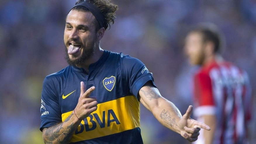 Boca Juniors' forward Daniel Osvaldo (L) celebrates after scoring the team's second goal against Estudiantes during their Argentina First Division football match at La Bombonera stadium in Buenos Aires, Argentina, on March 29, 2015. AFP PHOTO / ALEJANDRO PAGNI (Photo credit should read ALEJANDRO PAGNI/AFP/Getty Images)