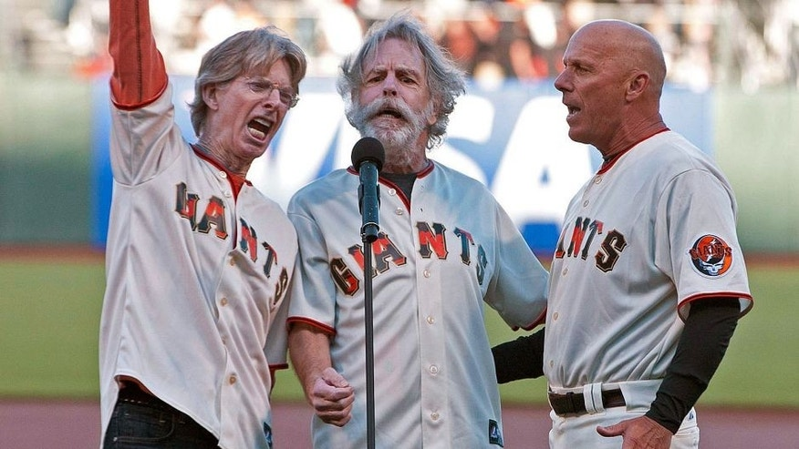 August 9, 2011; San Francisco, CA, USA; Grateful Dead band members Phil Lesh (left) and Bob Weir (center) sing the national anthem with San Francisco Giants third base coach Tim Flannery (right) before the game against the Pittsburgh Pirates at AT&T Park. Mandatory Credit: Jason O. Watson-USA TODAY Sports