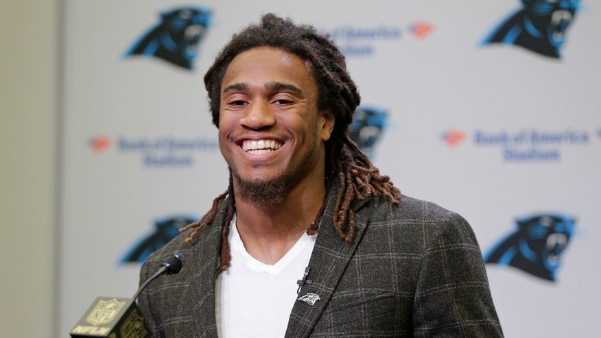 Carolina Panthers first round NFL draft choice Shaq Thompson smiles as he speaks to the media during a news conference in Charlotte, N.C., Friday, May 1, 2015. (AP Photo/Chuck Burton)