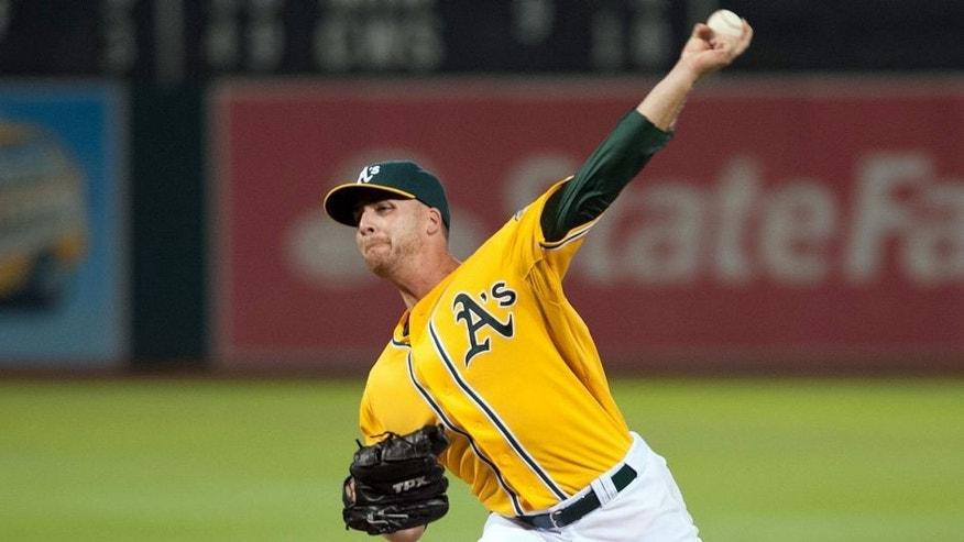 Aug 1, 2014; Oakland, CA, USA; Oakland Athletics relief pitcher Eric O'Flaherty (39) throws a pitch against the Kansas City Royals during the eighth inning at O.co Coliseum. The Kansas City Royals defeated the Oakland Athletics 1-0. Mandatory Credit: Ed Szczepanski-USA TODAY Sports