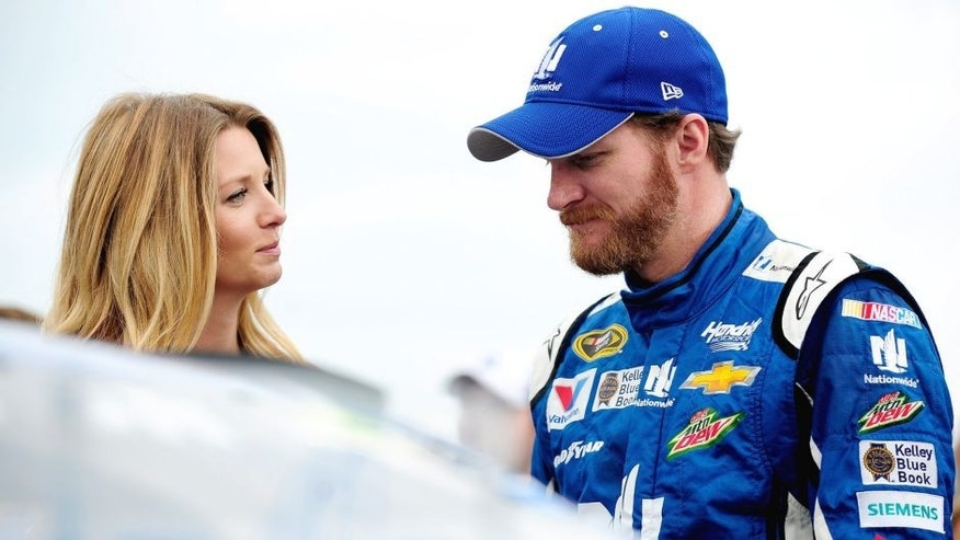 SPARTA, KY - JULY 11: Dale Earnhardt Jr., driver of the #88 Nationwide Chevrolet, right, takes part in pre-race ceremonies with fiancee Amy Reimann prior to the NASCAR Sprint Cup Series Quaker State 400 presented by Advance Auto Parts at Kentucky Speedway on July 11, 2015 in Sparta, Kentucky. (Photo by Jeff Curry/Getty Images)