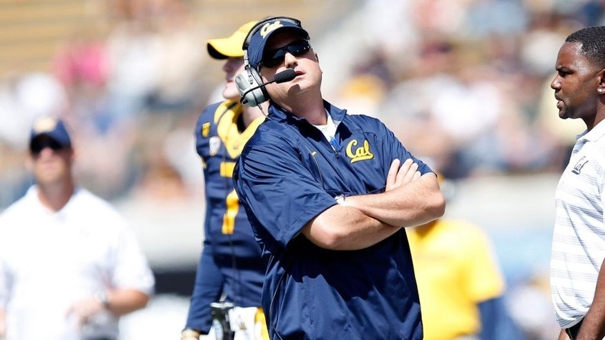 Sep 6, 2014; Berkeley, CA, USA; California Golden Bears head coach Sonny Dykes looks at the scoreboard from the sidelines during the first quarter in a game against the Sacramento State Hornets at Memorial Stadium. Mandatory Credit: Bob Stanton-USA TODAY Sports